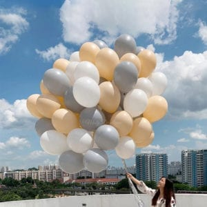 Peach, blush and white helium balloons bouquet